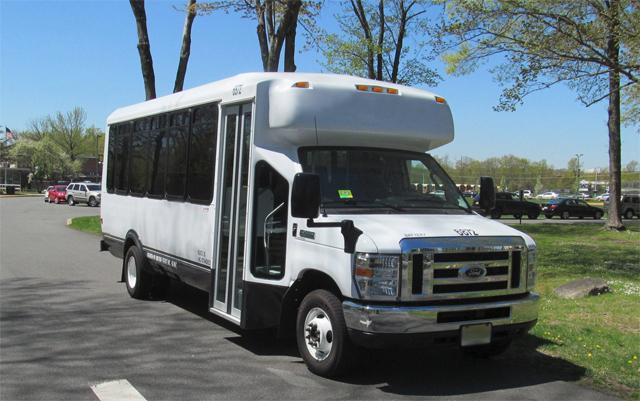 White 25 Passenger Shuttle Bus CITYNAME